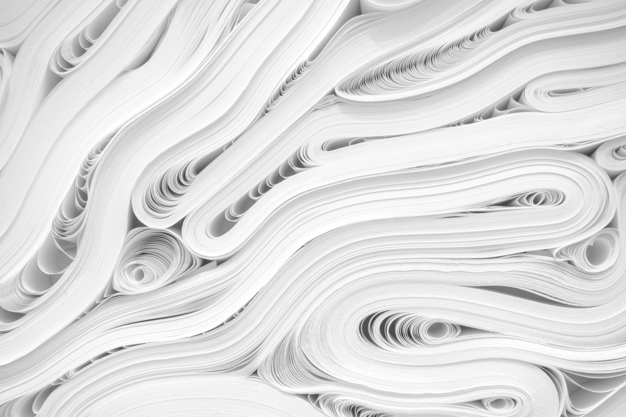 newspaper stacks with obituaries